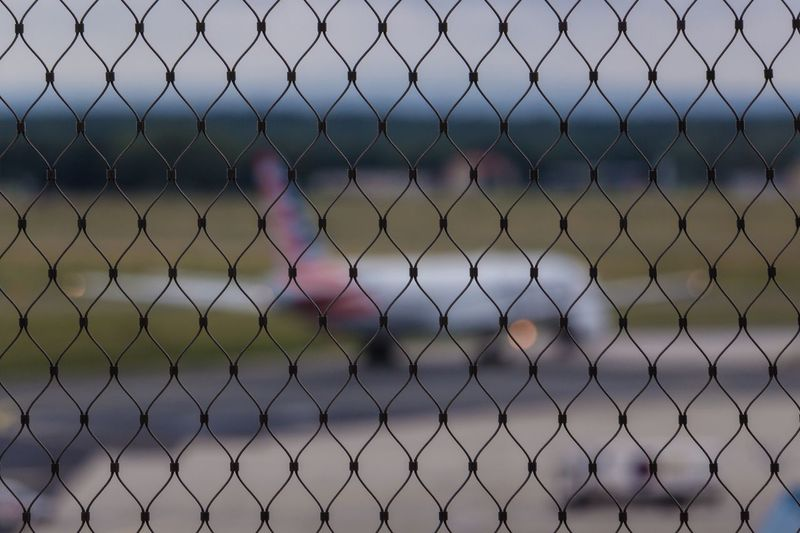 Airplanes and fences. Chainlink Fence Focus On Foreground No People Day Outdoors Backgrounds Close-up Nature Sky Airport Airplane Air Vehicle Aircraft Aircraft Wing Aircraft Photography Aircraft On The Ground Frankfurt Am Main Frankfurt Airport