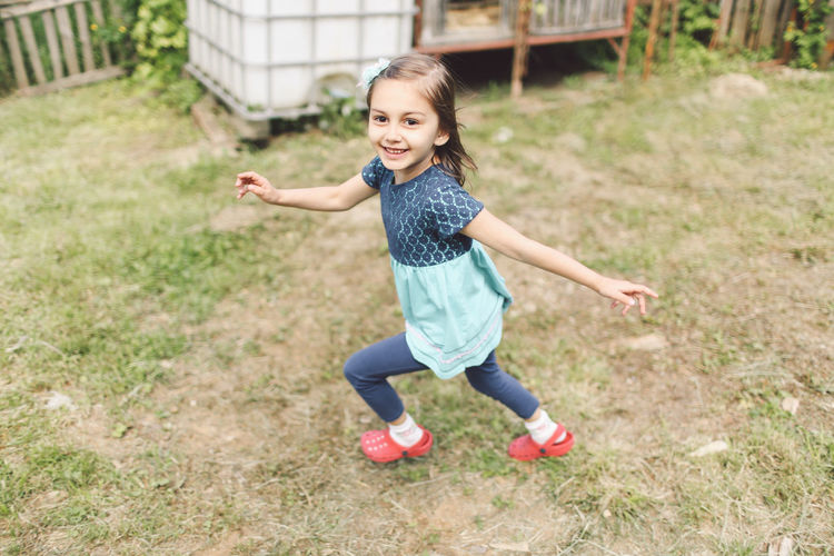 Casual Clothing Child Childhood Cute Elementary Age Enjoyment Focus On Foreground Full Length Fun Fun Girl Grass Grassy Happiness Innocence Leisure Activity Lifestyles Outdoors Person Portrait Running Smile Smiling Toothy Smile People And Places