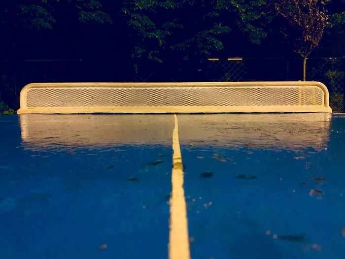 High angle view of raindrops on swimming pool