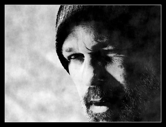 Adult Alertness Blackandwhite Photography Close-up Day High Contrast Human Body Part Human Face Incredulous Knitted Hat Lifestyles One Man Only One Person Outdoors People Portrait Sceptical Wary Young Adult The Portraitist - 2017 EyeEm Awards