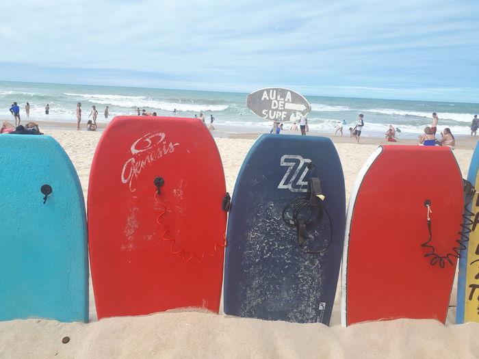 Aula de Surf Water Sea Beach Wave Sand Red Summer Lifeguard  Sky Surf Surfing Surfboard Water Sport Shore Summer Road Tripping The Great Outdoors - 2018 EyeEm Awards EyeEmNewHere The Creative - 2018 EyeEm Awards