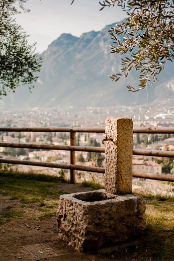 Water Sky Nature Lake No People Day Beauty In Nature Sunlight Scenics Outdoors Tranquility Mountain Tree Well  Italianstyle Garda Tranquil Scene Tranquility Idyllic Italy Cityscape Italy Photos Italy Holidays TOWNSCAPE Town