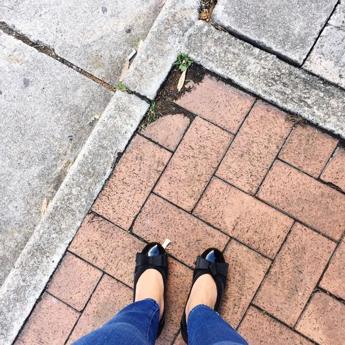 Waiting Ladies Shoes Urban Style Urban Floor Road Plant Streets Tiles Street Floors Jeans Waiting Red Tiles Shoes Of The Day Street Low Section Human Leg Standing High Angle View Personal Perspective Shoe Real People Stone Tile