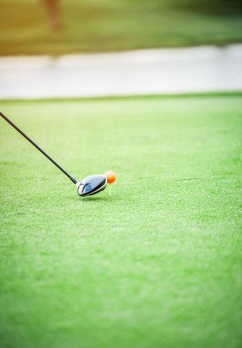 Golf Ball Teeing Off On Field