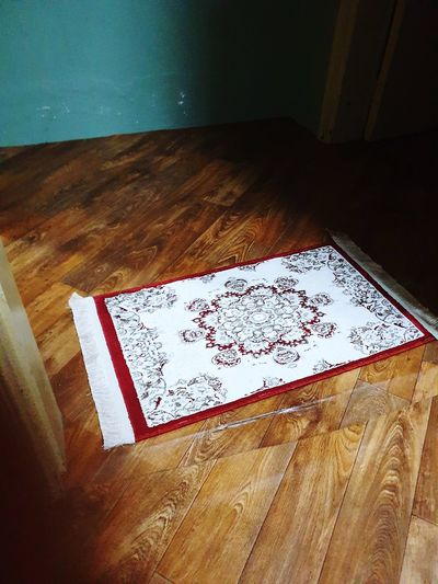 High angle view of text on wooden floor
