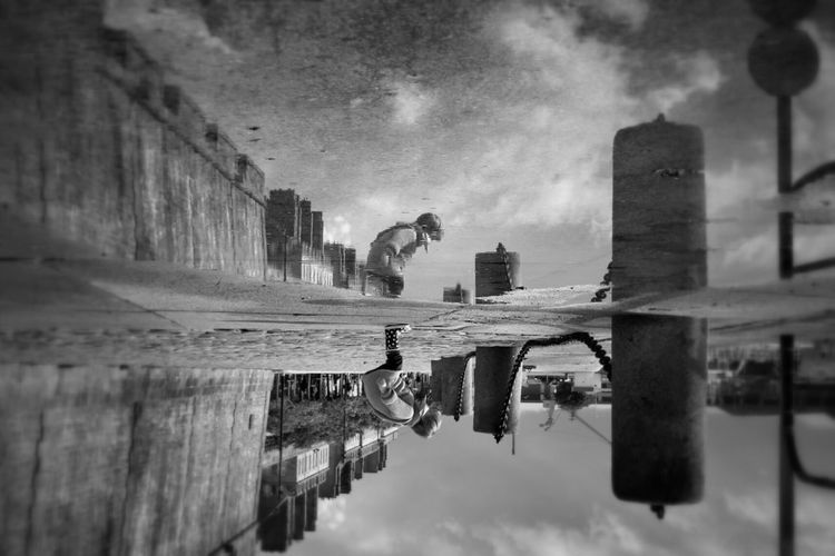 Find a parallel world... Reflection Waterfront Water Blackandwhite Capture The Moment AMPt - Shoot Or Die Street Life Capturing Freedom Street Photography Streetphoto_bw