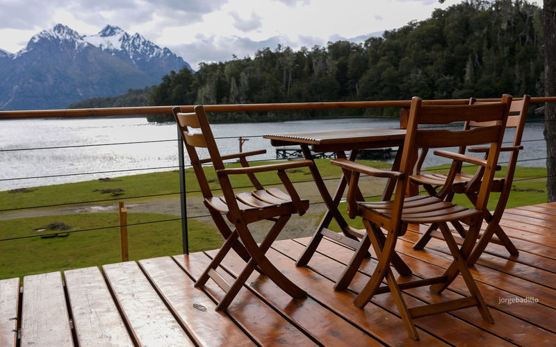 Hotel #LlaoLlao #Argentina #Bariloche Mountain Wood - Material Table Tree Seat No People Beauty In Nature Plant Empty Nature Tranquility Day Tranquil Scene Absence Scenics - Nature Chair Water Railing Non-urban Scene Lake Llao Llao Bariloche Bariloche, Argentina Patagonia Argentina