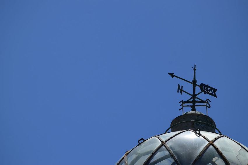 Now you're asking... Taking Photos Hello World Eye Em Best Shots Outdoors Minimalist Minimalmood Minimalism Direction Weather Vane Lighthouse Blue Sky North South East West EyeEm Best Shots Relaxing Cool Clear Sky