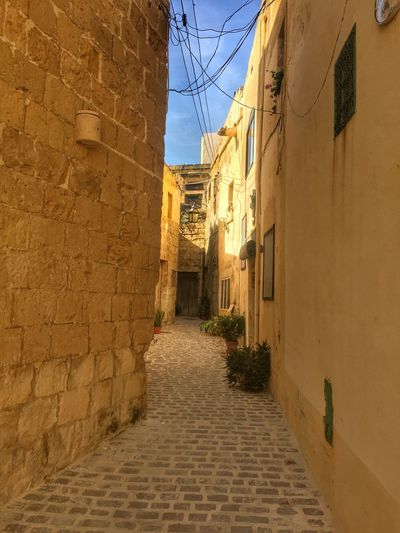 Narrow Alley in Victoria, Gozo Island, Malta Alley Architecture Building Exterior Built Structure Day No People Outdoors Residential Building Sky The Way Forward
