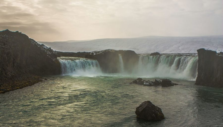 Scenic view of dettifoss against sky at sunset