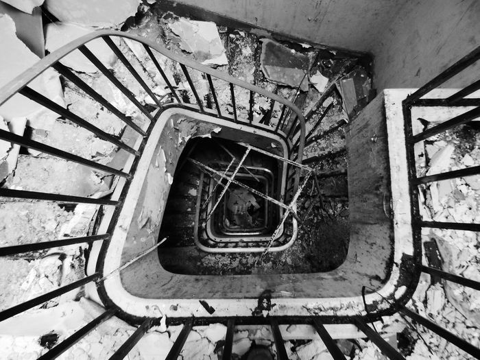 Spiral Staircase Hand Rail Stairs Steps And Staircases Spiral Spiral Stairs Steps Staircase Railing High Angle View Repetition