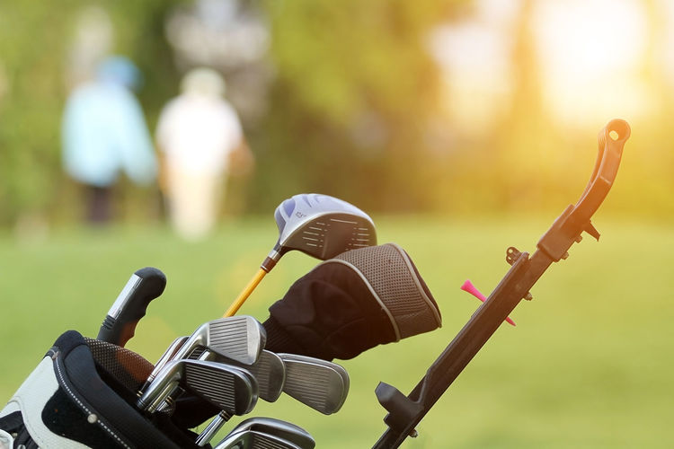 Close-up of golf club on grassy field