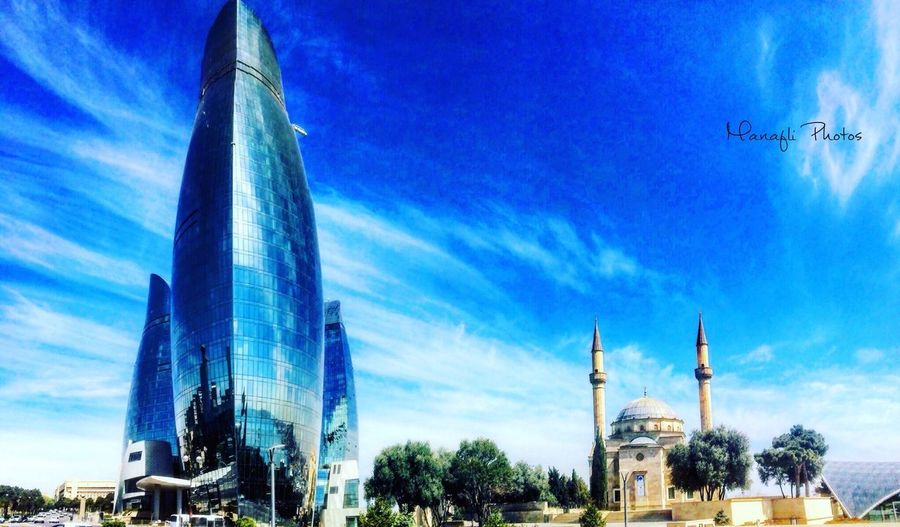 Baku Azerbaijan Flametowers Architecture Built Structure Building Exterior Sky Blue Tower City No People Skyscraper Outdoors Day Low Angle View Cloud - Sky Place Of Worship Cityscape Travel Destinations EyeEm Best Shots EyeEm Nature Lover Tourist City First Eyeem Photo Traveling