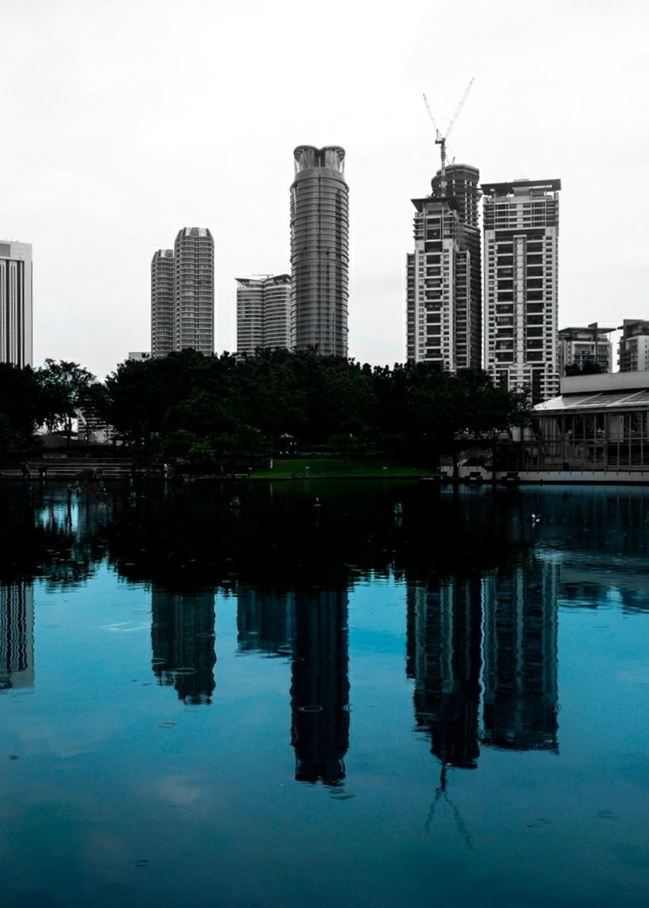 architecture, reflection, building exterior, built structure, city, skyscraper, water, waterfront, modern, no people, cityscape, sky, outdoors, day