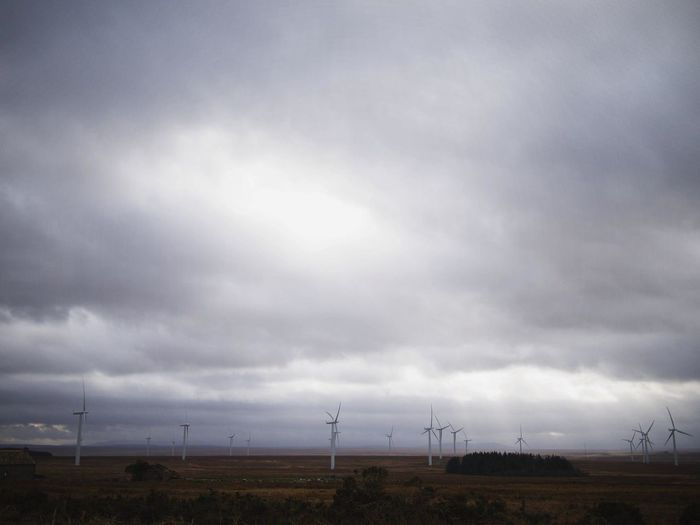 Cloud - Sky Day Electricity  Landscape Nature No People Outdoors Sky Stormy Wind Turbine Wind Turbine Tower Wind Turbines Wind Turbines On A Field Windmill