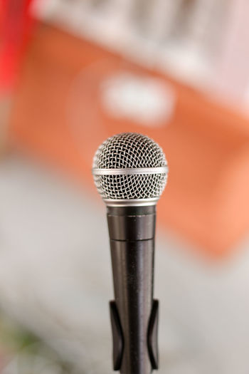 Microphone Microphone Input Device Arts Culture And Entertainment Close-up Music Communication Performance Technology Selective Focus Single Object Indoors  Metal Silver Colored Sound Recording Equipment Singing Equipment No People Audio Equipment Absence Studio Shot Speech Report