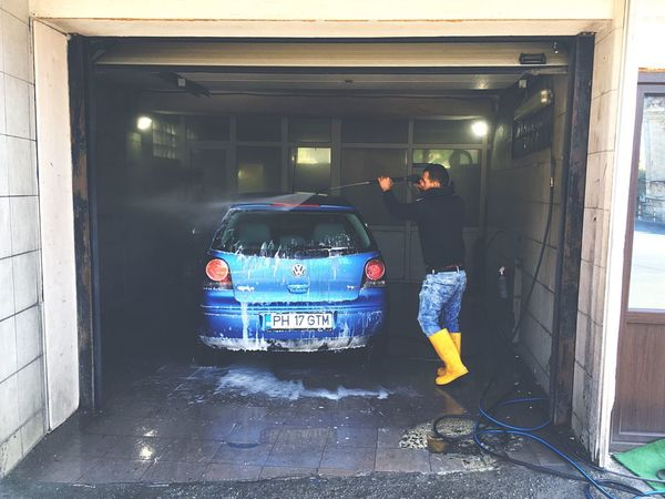 Vw Polo wash Foam Wash Clean Car Blue Car Volkswagen VW Polo VW Car Real People Men Standing Cleaning Built Structure Day Car Wash One Person People Outdoors