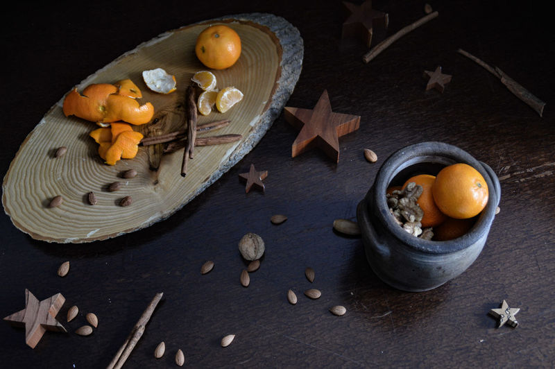 Flavours and aroma of autumn No People Dark Photography Dark Food Photography Autumn Flat Lay Autumn Flavor Clove Low Light Photography No People Top View The Week on EyeEm Autumn Mood Fall Season Still Life Photography Autumn Theme Space Anise Christmas Black Color Dark Close-up Sweet Food Garlic Clove Zest Cinnamon Cardamom Spice