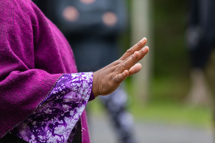 Close-up of woman hand holding purple outdoors