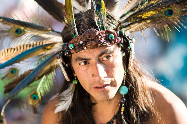 Met this guy along my journey in Mexico. He and his clan are descendents of the aztec culture, performing their ritual dance. Arts Culture And Entertainment Close-up Cultures Feather  Headshot Lifestyles Looking Away One Person Outdoors Peacock Feather Performance Portrait Traditional Clothing