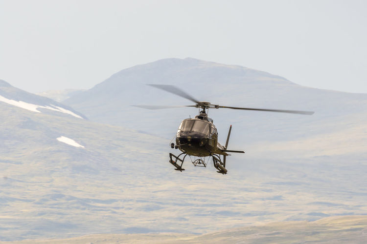 Helicopter flying in the wilderness