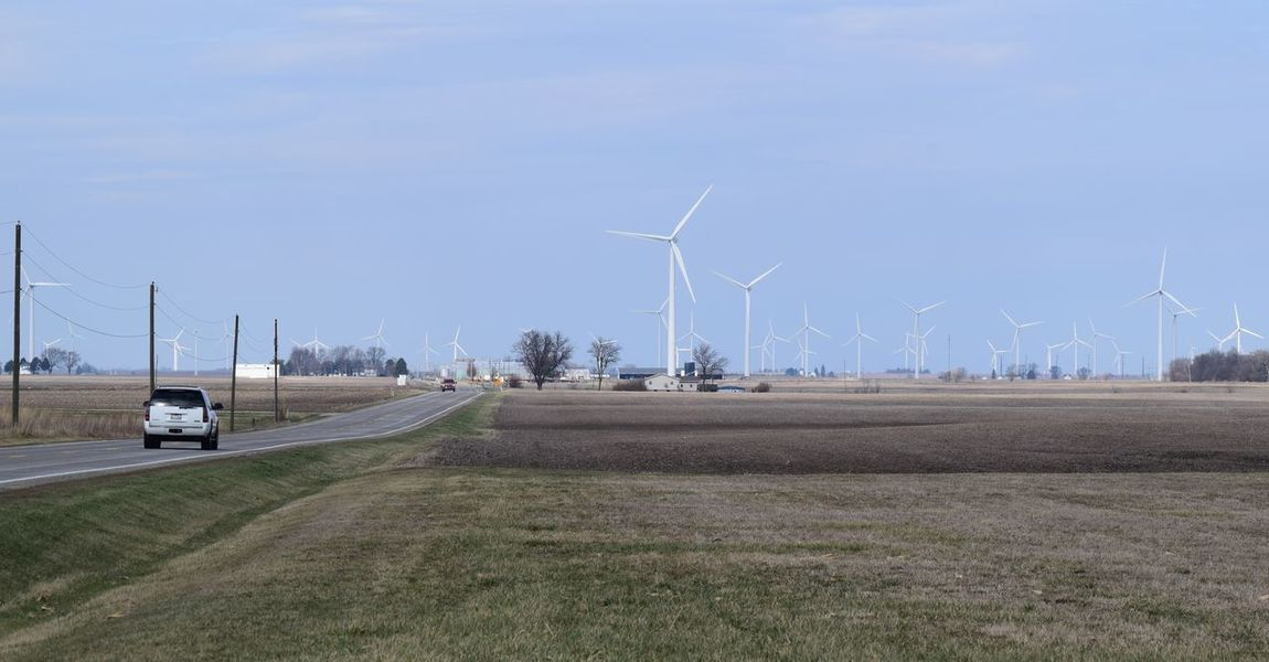 Wind Power in Northwestern Indiana Alternative Energy Clear Sky Day Environmental Conservation Fuel And Power Generation Grass Landscape Nature No People Outdoors Renewable Energy Rural Scene Sky Tree Wind Power Wind Turbine Windmill