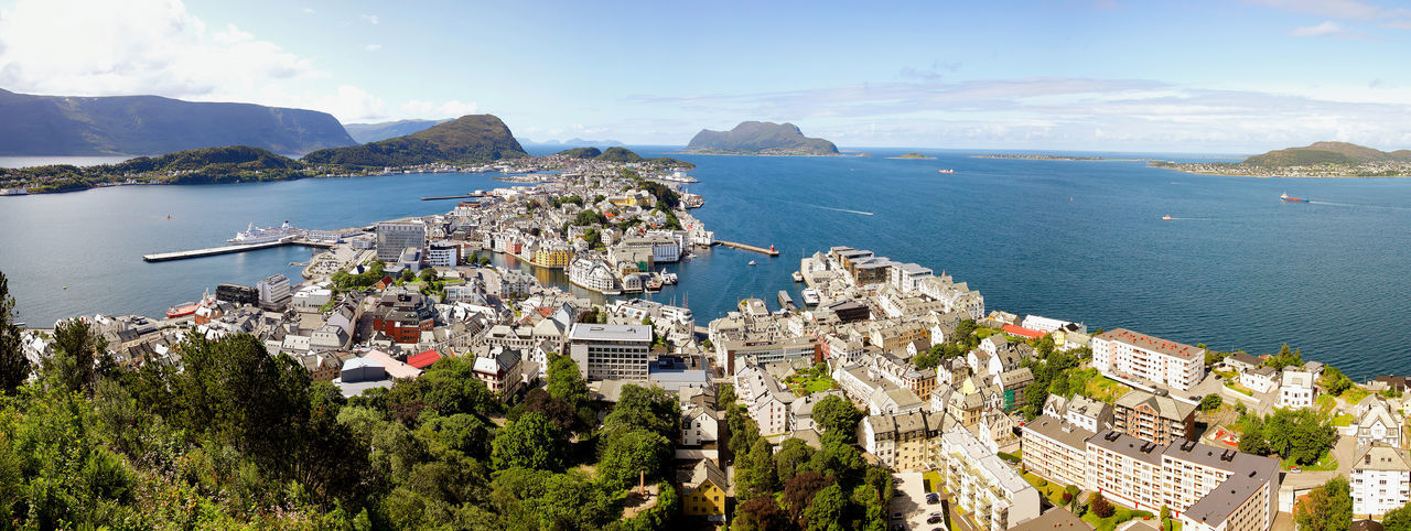 Alesund panorama. City on the north-west coast of Norway surrounded by high mountains and deep fjords. Alesund Architecture Building Exterior Built Structure City Cityscape Day Mountain Nature No People Norway Outdoors Panorama Panoramic Photography Panoramic View Scandinavia Scenics Sea Sky Travel Destinations Traveling Home For The Holidays Travelphotography Water Ålesund, Norway