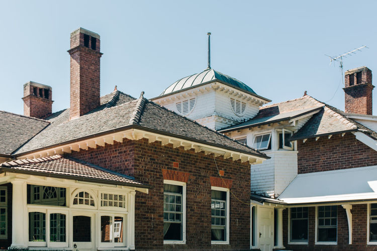Building Exterior Built Structure Architecture Building Sky Window Clear Sky Day Low Angle View House Roof Nature Residential District No People City Outdoors Sunlight Blue Copy Space Old Row House Roof Tile