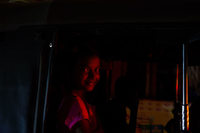 The streets were bustling and writhing with energy in Galle as Sri Lankans celebrated Vesak, the day of Buddah. Shooting from a Tuk Tuk in low light is extremely difficult in ever changing circumstances with light shifting every time traffic moves. Sri Lanka The Portraitist - 2018 EyeEm Awards The Street Photographer - 2018 EyeEm Awards TukTuk Dark Emotion Illuminated Lifestyles Night People Portrait Real People Rickshaw Smiling Vesak Young Adult