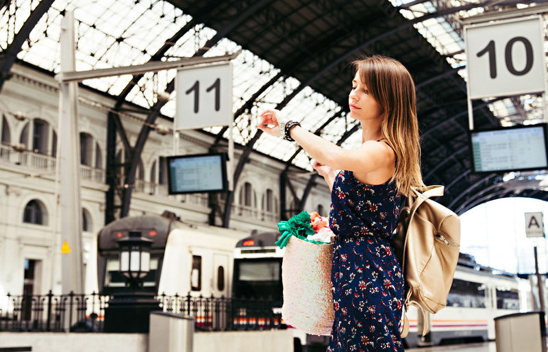 Adult Adults Only Beautiful People Beautiful Woman Beauty City Consumerism Customer  Day Fashion Lifestyles One Person One Woman Only One Young Woman Only Only Women Outdoors People Real People Standing Train Station Traveling Waiting Women Young Adult Young Women