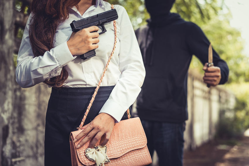 Knife Martial Arts Wall Adult Blackandwhite Day Gun Handgun Hiding Holding Lifestyles One Person Outdoors People Prevent Protection Purse Real People Robber Safety Standing Steal Streetphotography Weapon Women