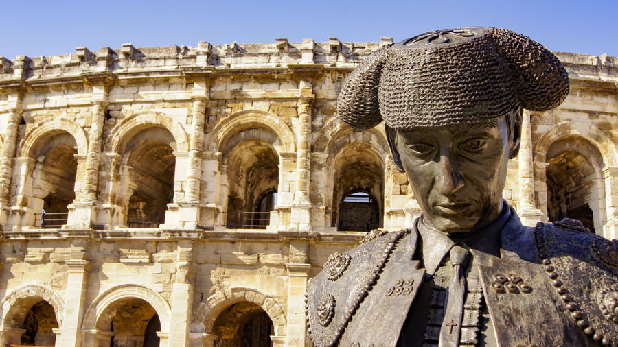 Ancient Ancient Civilization Architecture Building Exterior Built Structure Bull Fighter Bull Ring Day History Human Representation Nimes France No People Nîmes Outdoors Sculpture Statue Travel Destinations Neighborhood Map An Eye For Travel The Architect - 2018 EyeEm Awards