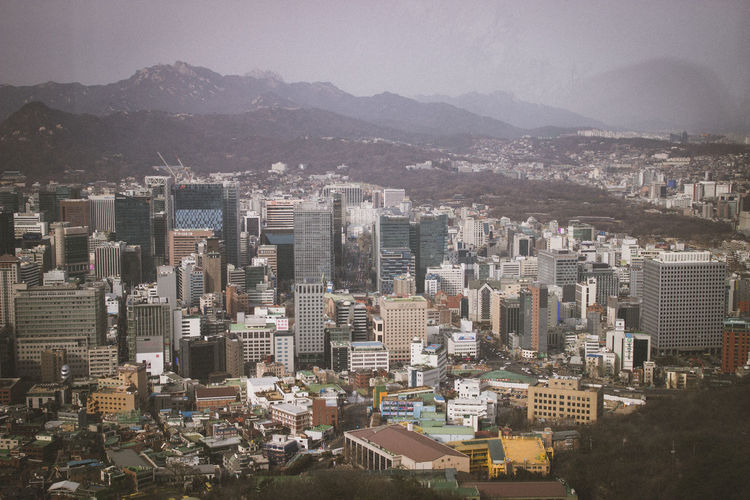 High angle view of buildings in city against sky in seoul, south korea