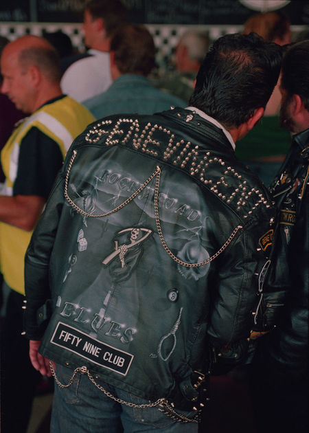 Biker Boys, Gene Vincent Arts Culture And Entertainment Bikers Brotherhood Mc British Rockers Casual Clothing Communication Documentary Nature Photography Photography Taking Photos A Focus On Foreground Gene Vincent Holding Incidental People Large Group Of People Leathers Leisure Activity Lifestyles Medium Group Of People Men Person Photographing Photography Themes Rear View Reportage Images Taking Photos Photography From My Point Of View Standing Technology