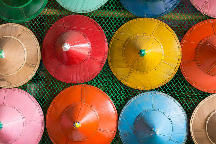 High angle view of multi colored hats at market for sale