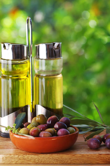 olives fruit and olive oil Close-up Container Food Food And Drink Fruit Green Color Oil Olive Olive Oil Olives Fruit And Olive Oil Table Vegetable