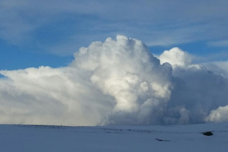 Clouds Rolling In White And Blue Snow