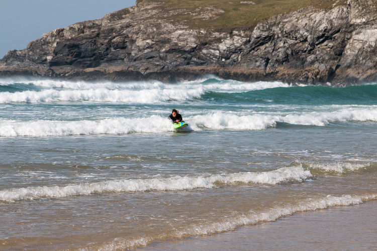 Surfs up at Holywell Bay in Cornwall Surf Surfer Adventure Aquatic Sport Beach Beauty In Nature Cornwall Cornwall Uk Day Extreme Sports Horizon Over Water Land Leisure Activity Lifestyles Men Motion Nature One Person Outdoors Sea Sport Surfing Surfingphotography Water Wave