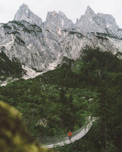 Hanging bridge in Berchtesgaden, Bayern, Germany with orange jacket. My Best Photo Mountain Mountain Range Beauty In Nature Scenics - Nature Nature Day Outdoors Bridge Hanging Bridge Berchtesgaden Berchtesgadener Land  Berchtesgaden , Germany Berchtesgaden Alps