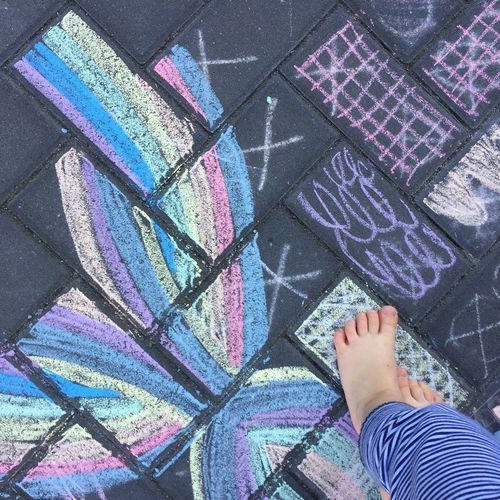 Low Section Of Child Standing On Chalk Drawing
