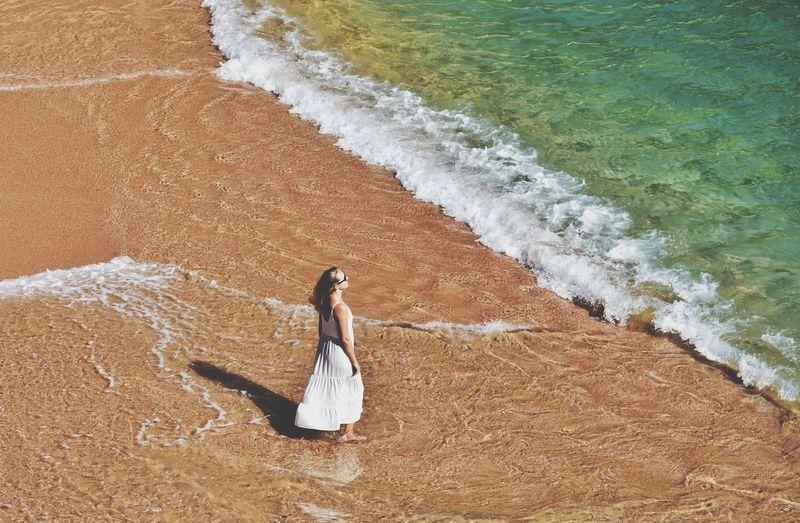 Woman walking on the cala pola beach in costa brava in spain