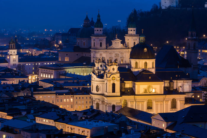 The city of Salzburg at dusk Austria Blue Hour Church Memorial Travel Architecture Building Building Exterior Built Structure City Cityscape Destination Dome Dusk Europe High Angle View Illuminated Landmark Night Nightfall Outdoors Place Of Worship Religion Salzburg