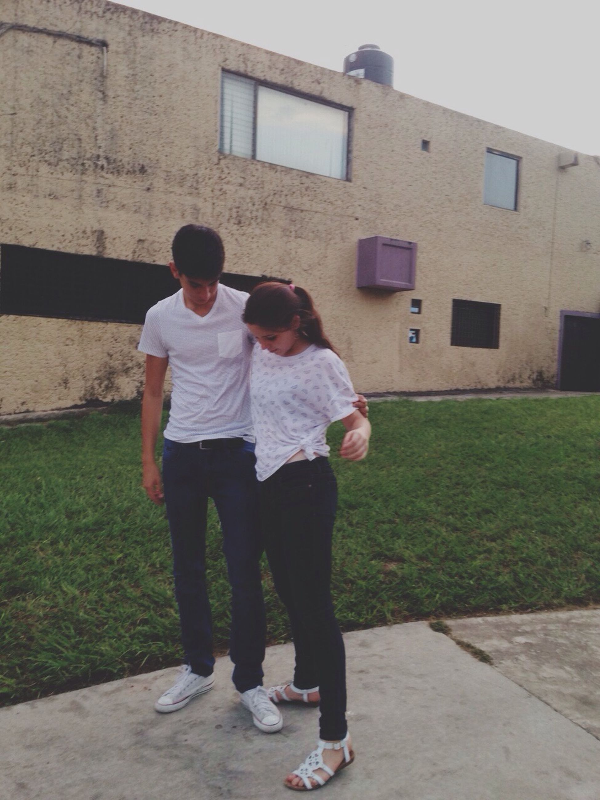 full length, childhood, boys, lifestyles, casual clothing, leisure activity, elementary age, building exterior, built structure, architecture, togetherness, girls, person, bonding, love, innocence, grass