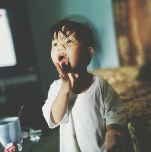 Close-up of boy eating chocolate