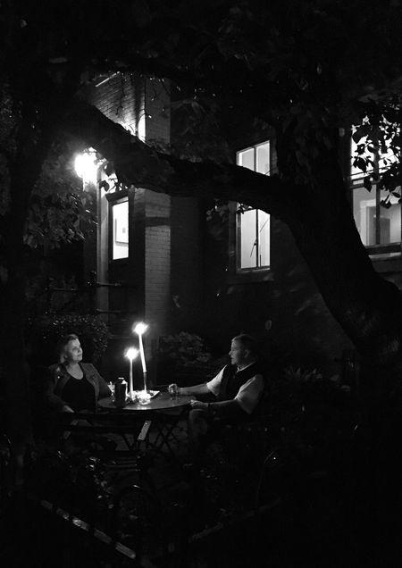 Evening conversation Blackandwhite Architecture Burning Illuminated Night Flame Candle Built Structure Real People Architecture People Outdoors