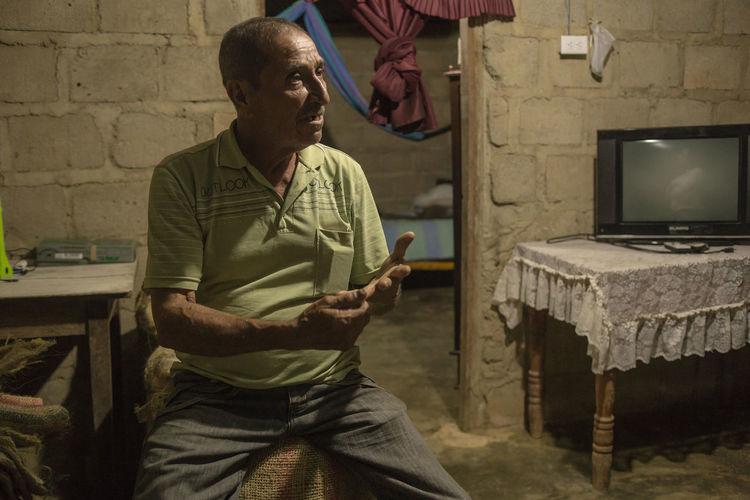 Coffee Region Home Interior Interview Men Portrait Senior Adult Sitting Talking Village People