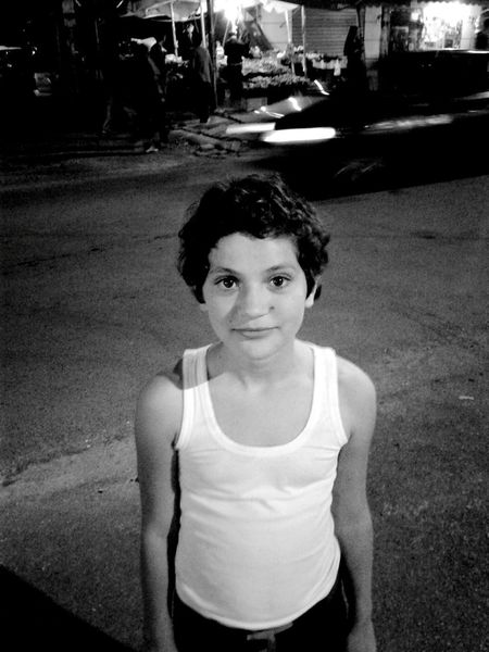 """It's not you that is black. It's the world. The colour of your skin doesn't define YOU."" NoToRacism Equality Little Girl With Human Colours Monochrome Photography The story after this pic: saw her at a garbage bin collecting cans for selling at recycling stores. Decided to take her a pic. Gave her some money and food. She's a great girl."