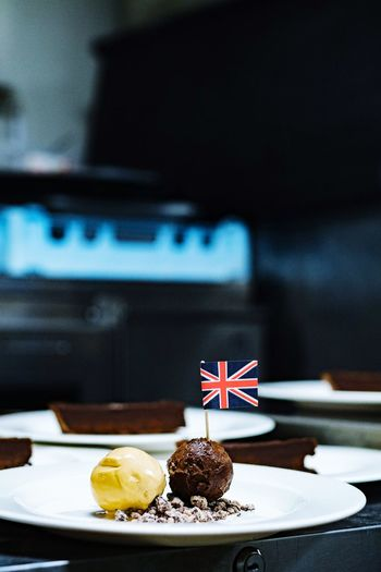Dessert with british flag in plate on table