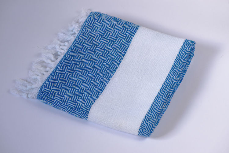 High angle view of blue paper on table against white background