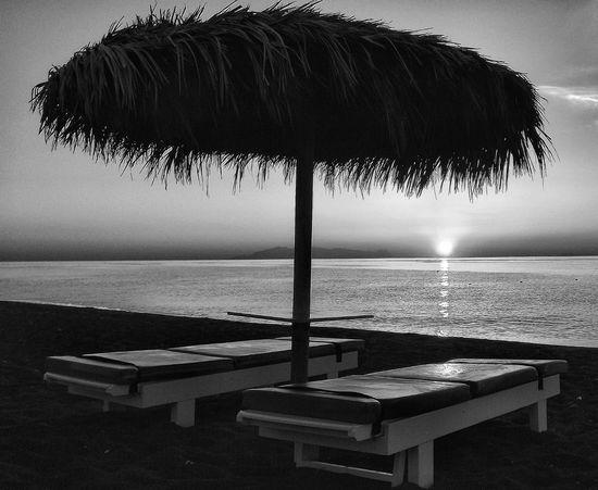 Beautiful sunrise on perissa beach Santorini Greece Sea Water Horizon Over Water Beauty In Nature Tranquil Scene Scenics Sky Fujifilm Malephotographerofthemonth Beauty In Nature Landscape Dramatic Sky Sunlight Sunrise - Dawn Sunriseshot Sunrise Photography Sunrise On The Beach